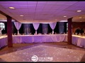 Dancefloor with black drape backdrop and sheer swags.