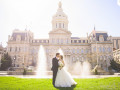 bride and groom kiss at city hall baltimore