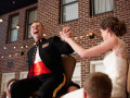 bride and groom doing hora in chairs