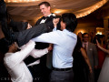 guests lifting groom in the air