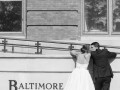 bride and groom kiss outside Baltimore Marriott Waterfront