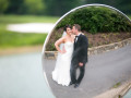 bride and groom kiss in the mirror