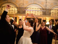 bride and groom with wedding guests dancing