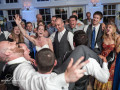bride and groom sing with wedding guests