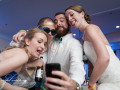 wedding guests and bride take a selfie