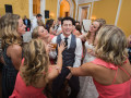 groom and bride dancing with bridesmaids