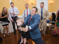 wedding guest holding baby while dancing at wedding