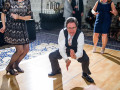 older wedding guest dancing low to ground