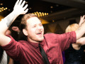 wedding guest waving arms during dancing