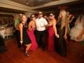 wedding guests wearing sunglasses during dancing
