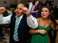 bridesmaid and groomsman dancing