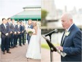 bride walking down aisle while father of the groom sings