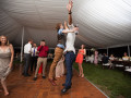two wedding guests chest bumping in the air
