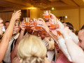 wedding guests clinking glasses together