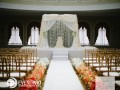 Stage with draped canopy in sheer. Flowers by My Flower Box Events. Photos by Dani Leigh Photography