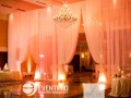 The drape wall divides the ballroom between tables and a lounge area. Photos by Dani Leigh Photography