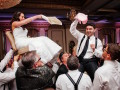 bride and groom in chairs for hora dance