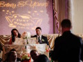 bride and groom sitting at table