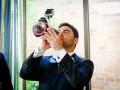 groom drinking whiskey