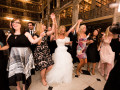 bride holding hands with other guests during dancing