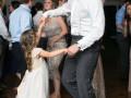 flowergirl dancing with groom