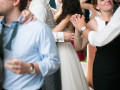 bride and groom staring at each other romantically on the dance floor