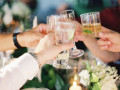 guests clinking glasses together at table