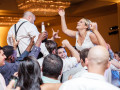 bride and groom raised up on guests shoulders