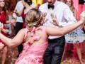 bridesmaid and groomsmen dancing