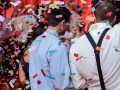 wedding guests covered in confetti