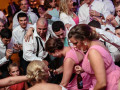 wedding guests dancing tightly in group